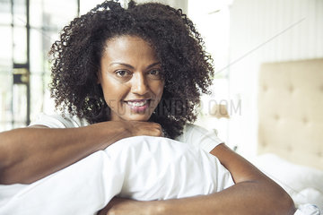 Woman holding pillow  portrait