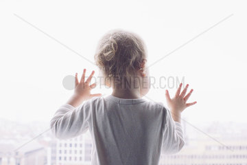 Baby looking out of window