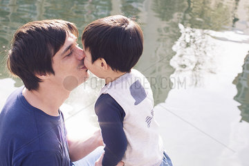 Father kissing little boy
