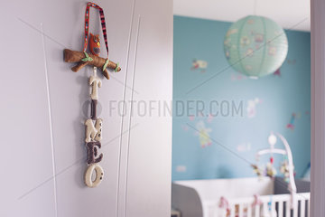 Decoration of baby's name hanging on nursery door