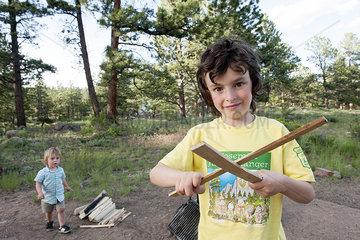 Boy preparing to build a campfire  portrait