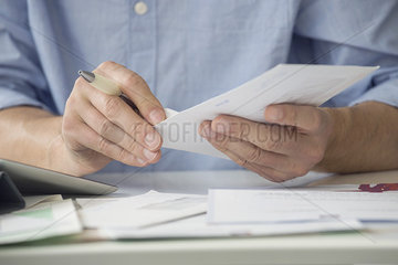 Man opening mail