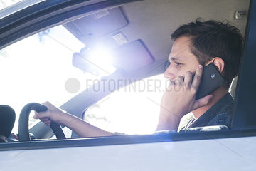 Driver using cell phone without hands-free device while driving