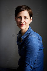 Portrait of ana ttractive woman  wearing denim shirt