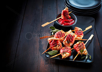 Saltimbocca skewers on serving tray