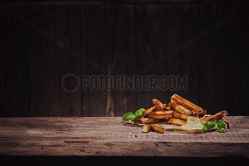 Hand made french fries with mayonnaise on wood