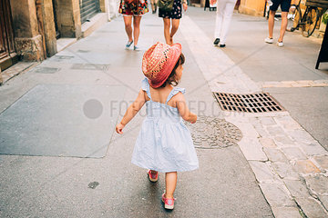 France  Aix-en-Provence  toddler girl walking down the streets of the city center