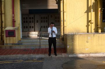 Republik Singapur  Raucher in Chinatown