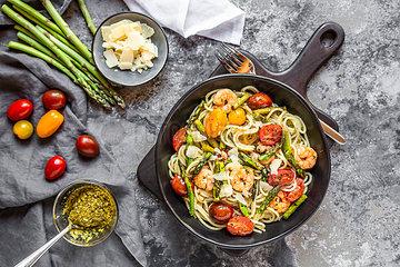 spaghetti with shrimps  green asparagus  tomato  pesto and parmesan