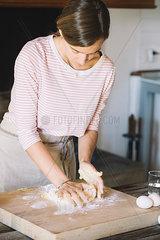 Woman preparing dough  flour and eggs