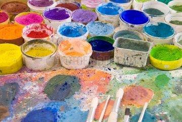 brushes on an artistÂ's palette