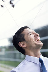 Businessman laughing outdoors