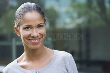 Woman smiling cheerfully  cropped