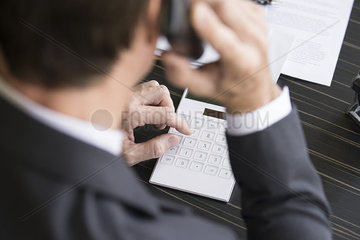 Accountant reviewing financial accounts