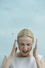 Woman shouting with eyes closed