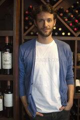 Sommellier in wine cellar  portrait