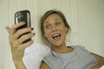 Woman smiling  taking selfie