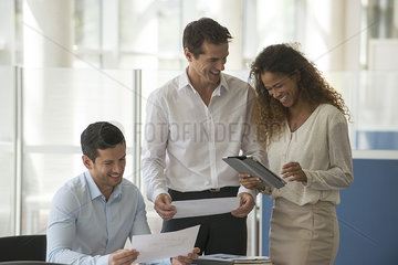 Business professionals marveling at results