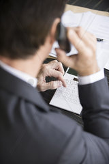 Accountant making phone call