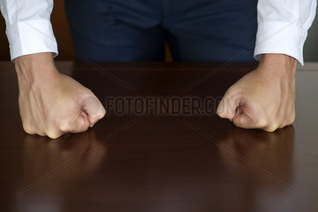 Businessman clenching fists  cropped