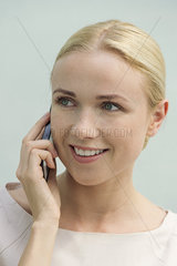 Woman talkiing on cell phone  smiling
