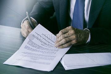 Executive signing document