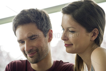Couple relaxing together  both smiling