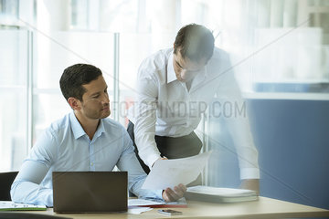 Businessmen reviewing document together