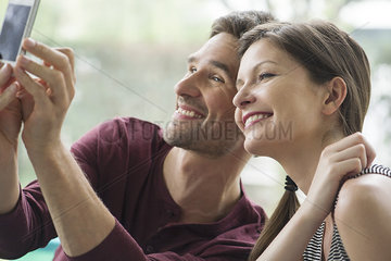 Couple posing for a selfie with a smartphone