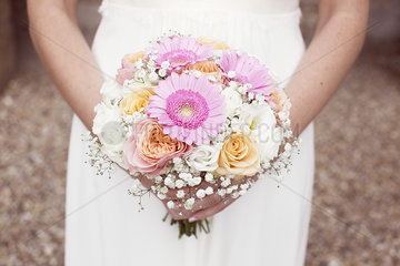 Bride holding bouquet of flowers  cropped