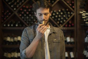 Sommelier smelling wine cork