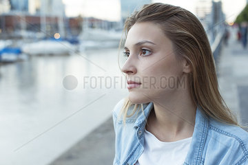 Young woman looking away in thought