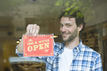 Businessman opening shop for business