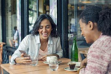 Friends meeting at sidewalk cafe