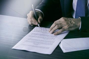 Businessman signing document