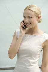 Young businesswoman talking on cell phone  smiling