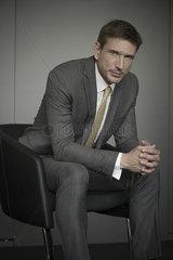 Businessman sitting in chair  portrait