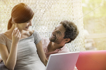 Couple making purchase online with credit card