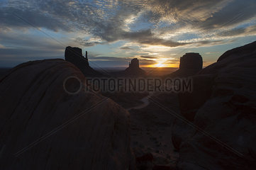 Sunset behind buttes in Monument Valley  Utah  USA