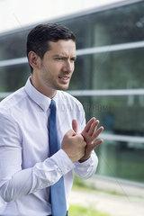 Businessman clenching fist in determination