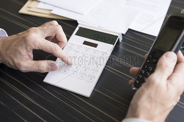Using calculator and cell phone