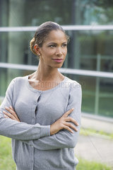 Woman with arms folded across chest  determined expression on face  portrait