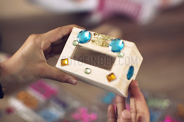 Child decorating box with stick-on jewels  cropped