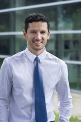 Businessman smiling outdoors  portrait