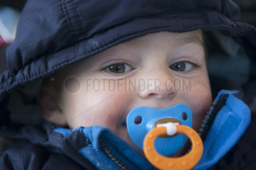 Toddler boy with pacifier in his mouth  portrait