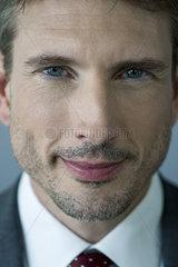 Businessman smiling  close-up portrait