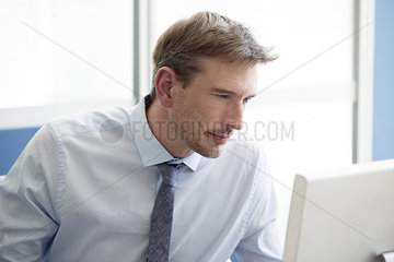 Graphic designer concentrating on project