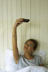 Woman in bed taking selfie