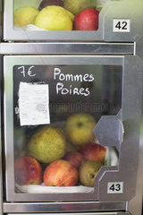 Food locker containing apples and pears in self-serve grocery