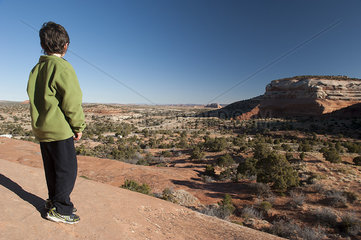 Boy looking at scenic desert view in Utah  USA